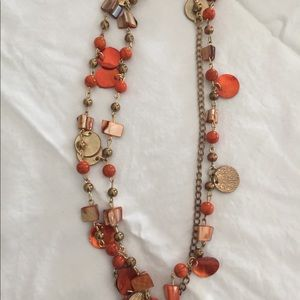 Beaded necklace. Gold and orange.